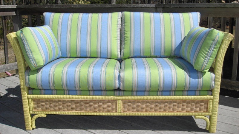 Wicker Love Seat Upholstered in a Sunbrella fabric | Cape Cod Upholstery Shop | Located in South Dennis, Ma