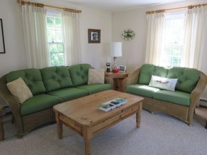 Wicker Sofa & Loveseat Cushions in a Sunbrella Spectrum Fabric | Joe Gramm Upholsterer | cape Cod Upholstery Shop Located in South Dennis, MA