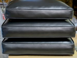Black Vinyl Sofa Cushions showing the boxing and welting cord | Upholstered by Cape Cod Upholstery Shop | Located in South Dennis, MA