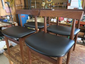 Teak Danish Chairs in a Contract Grade Black Vinyl | Upholstered by Cape Cod Upholstery Shop | Located in South Dennis, MA