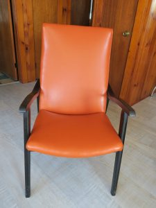 Wood Arm Chair Upholstered in a Pumpkin Vinyl Fabric | Upholstered by Cape Cod Upholstery Shop | Located in South Dennis, MA