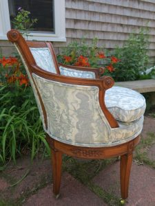 Side view of an exposed wood barrel swivel chair   Upholstered in a JF Fabrics Crypton   Upholstered by Cape Cod Upholstery Shop   Located in South Dennis, MA