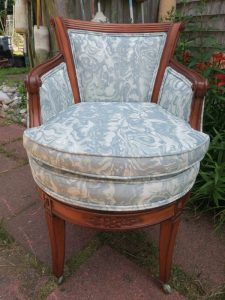 Front view of an exposed wood barrel swivel chair   Upholstered in a JF Fabrics Crypton   Upholstered by Cape Cod Upholstery Shop   Located in South Dennis, MA