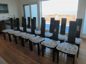 Set of 14 Custom Dining Chairs   Upholstered in an exclusive United Fabrics Sunbrella fabric   Upholstered by Cape Cod Upholstery Shop   Located in South Dennis, MA