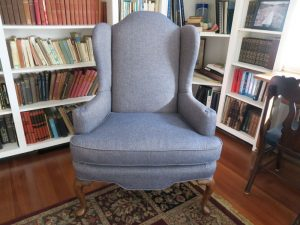 One of two wing chairs in the library room | Upholstered in a Greenhouse Fabrics | Upholstered by Cape Cod Upholstery Shop | Located in South Dennis, MA