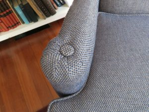 Wing chair arm finished with a button on top | Upholstered in a Greenhouse Fabrics | Upholstered by Cape Cod Upholstery Shop | Located in South Dennis, MA