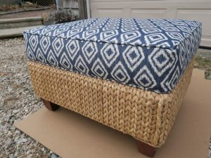 Wicker Ottoman with Attached Seat Cushion, Side View | Upholstered in a Greenhouse Fabrics | Upholstered by Cape Cod Upholstery Shop | Located in South Dennis, MA