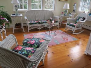 Antique Wicker Set | Upholstered in a Schumacher Chintz Floral Print | Upholstered by Cape Cod Upholstery Shop | Located in South Dennis, MA