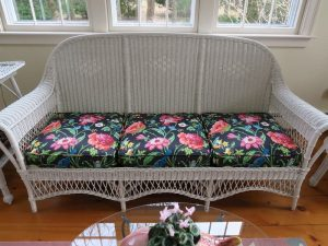 Antique Wicker Sofa | Upholstered in a Schumacher Chintz Floral Print | Upholstered by Cape Cod Upholstery Shop | Located in South Dennis, MA
