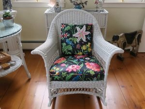 Antique Wicker Rocking Chair | Upholstered in a Schumacher Chintz Floral Print | Upholstered by Cape Cod Upholstery Shop | Located in South Dennis, MA