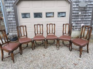 Set of Six Antique Dining Chairs | Upholstered in a Greenhouse Fabrics Faux Leather | Trimmed with Natural Finish Decorative Steel Nails | Upholstered by Cape Cod Upholstery Shop | Located in South Dennis, MA