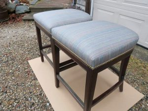 Kitchen Island Stools with Decorative Brass Nail Trim | Upholstered in Sunbrella Escapade-Electro | Upholstered by Cape Cod Upholstery Shop | Located in South Dennis, MA
