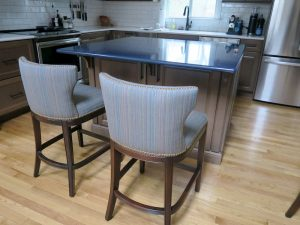 Kitchen Island Stool Backs | Detailed with Decorative Brass Nail Trim | Upholstered in Sunbrella Escapade-Electro | Upholstered by Cape Cod Upholstery Shop | Located in South Dennis, MA