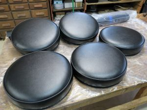 Round Black Vinyl Bar Stool Seats | Boxed Style Seats with Welting Top and Bottom | Upholstered by Cape Cod Upholstery Shop | Located in South Dennis, MA