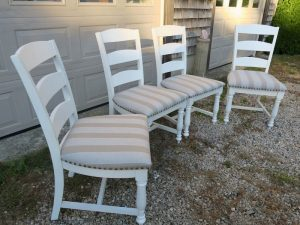 Set of four kitchen chairs | Upholstered in a Sunbrella stripe | Upholstered by Cape Cod Upholstery Shop | Located in South Dennis, MA
