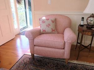 Upholstered Arm Chair with embroider Pillow | Upholstered in a Jane Shelton Fabic Willingham Red | Upholstered by Cape Cod Upholstery Shop | Located in South Dennis, MA 02660