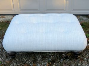 Large Buttoned Ottoman with decorative brass nail trim | Upholstered in a Sunbrella fabric | Upholstered by Cape Cod Upholstery Shop | Located in South Dennis, MA 02660