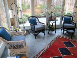 Wicker chairs with removable seat cushion and back pillow | Upholstered in a Stout Fabrics and Greenhouse Fabrics stripe and solid | Upholstered by Cape Cod Upholstery Shop | Located in South Dennis, MA 02660