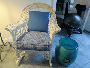 White wicker rocker with removable seat cushion and back pillow | Upholstered in a Stout Fabrics and Greenhouse Fabrics stripe and solid | Upholstered by Cape Cod Upholstery Shop | Located in South Dennis, MA 02660