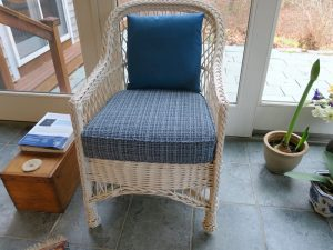 White wicker chair with removable seat cushion and back pillow | Upholstered in a Stout Fabrics and Greenhouse Fabrics stripe and solid | Upholstered by Cape Cod Upholstery Shop | Located in South Dennis, MA 02660