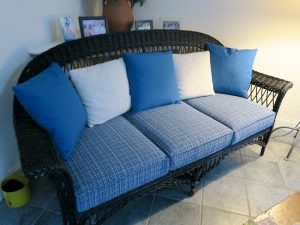 Wicker sofa with removable seat cushions and back pillows | Upholstered in a Stout Fabrics and Greenhouse Fabrics stripe and solid | Upholstered by Cape Cod Upholstery Shop | Located in South Dennis, MA 02660