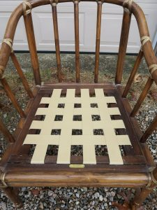 Pirelli Rubber Webbing with Clips, installed on a McGuire stick wicker chair | Upholstered by Cape Cod Upholstery Shop | Located in South Dennis, MA 02660