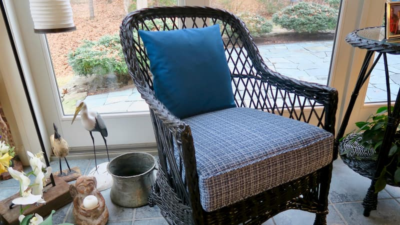 Vintage black wicker chair chair | Cushions made with Greenhouse Fabrics Crypton and Sunbrella fabric | Upholstered by Cape Cod Upholstery Shop | South Dennis, MA