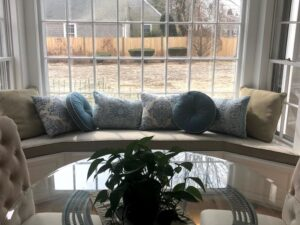 Dining room with a one piece Window Seat Cushion to fit bay window | Upholstered in a Revolution Base Fabric Upholstered by Cape Cod Upholstery Shop | Located in South Dennis, MA 02660
