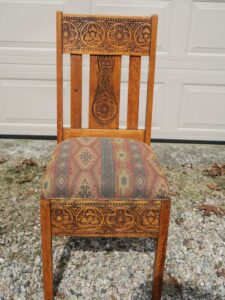 Oak Chair with South Western Style Carving | Upholstered in a United Fabrics South Western style fabric | Upholstered by Cape Cod Upholstery Shop | Located in South Dennis, MA 02660