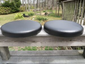 Round Bar Stool Seats with Boxing | Upholstered in black vinyl | Upholstered by Cape Cod Upholstery Shop | Located in South Dennis, MA 02660