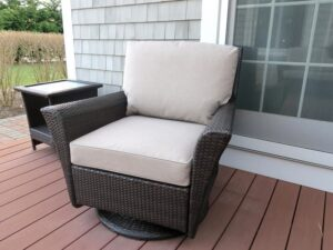 Brown Outdoor Wicker Swivel Chair | Cushions upholstered in Sunbrella Blend-Sand | Upholstered by Cape Cod Upholstery Shop | Located in South Dennis, MA 02660
