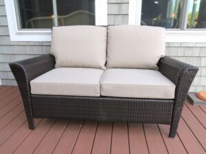 Brown Outdoor Wicker Love Seat | Cushions upholstered in Sunbrella Blend-Sand | Upholstered by Cape Cod Upholstery Shop | Located in South Dennis, MA 02660