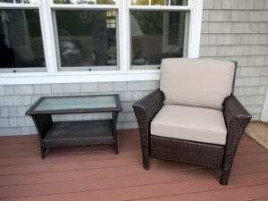 Brown Outdoor Wicker Chair | Cushions upholstered in Sunbrella Blend-Sand | Upholstered by Cape Cod Upholstery Shop | Located in South Dennis, MA 02660