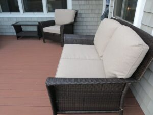 Brown Outdoor Wicker Love Seat & Chair | Cushions upholstered in Sunbrella Blend-Sand | Upholstered by Cape Cod Upholstery Shop | Located in South Dennis, MA 02660