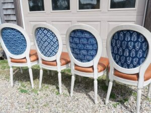 Chair backs upholstered with Batik Fabric imported from India | French arm and side chairs, upholstered in their original genuine leather, were part of This Old House Concord Cottage Season 25 | Batik fabric backs Upholstered by Cape Cod Upholstery Shop | Located in South Dennis, MA 02660