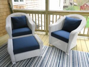 Lloyd Flanders white outdoor wicker chairs and ottoman | Cushions upholstered with Sunbrella Spectrum Indigo outdoor fabric | EZ-Dri foam inserts | Upholstered by Cape Cod Upholstery Shop | Located in South Dennis, MA 02660