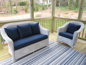 Lloyd Flanders white outdoor wicker chair and love seat | Cushions upholstered with Sunbrella Spectrum Indigo outdoor fabric | EZ-Dri foam inserts | Upholstered by Cape Cod Upholstery Shop | Located in South Dennis, MA 02660