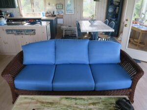 Ficks Reed Wicker Sofa | Freshly painted with a Benjamin Moore acrylic enamel paint by Dip N' Strip in Hyannis, Ma | Cushion Covers upholstered in a Performance JF Fabric | Upholstered by Cape Cod Upholstery Shop | Located in South Dennis, MA 02660
