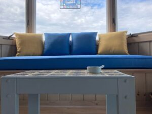 """85"""" window seat with four 18"""" square throw pillows 