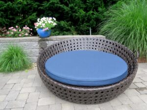 """Pool-side outdoor daybed used as a therapy cushion for a special needs customer. Outer cushion fabric is a Sunbrella Spectrum Indigo indoor-outdoor fabric. Under cushion cover made with BellBloc-68 waterproof fabric liner. Foam cushion core is 3"""" antibacterial marine foam from Sailrite. Upholstered by Cape Cod Upholstery Shop 