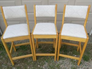 Front view of matching wood bar stools   Upholstered in a geometric pattern fabric   Upholstered by Cape Cod Upholstery Shop   Located in South Dennis, MA 02660