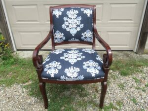 Front view of a wood arm chair upholstered in a cotton screen print fabric   Upholstered by Cape Cod Upholstery Shop   Located in South Dennis, MA 02660