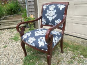 Side view of a wood arm chair upholstered in a cotton screen print fabric   Upholstered by Cape Cod Upholstery Shop   Located in South Dennis, MA 02660