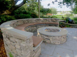 Five semi-circular fire pit cushions with a salt water view   Upholstered on the top and sides with a Sunbrella Canvas Chestnut and Phifertex mesh fabric on the bottom   Ez-Dri outdoor foam   Upholstered by Cape Cod Upholstery Shop   Located in South Dennis, MA 02660