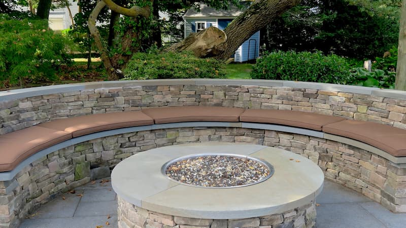 Fire Pit Cushions on Bass River | Upholstered on the top and sides with Sunbrella Canvas-Chestnut and on the bottom with Phifertex mesh for drainage | Upholstered by Cape Cod Upholstery Shop | Located in South Dennis, MA 02660