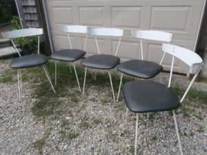 """Outdoor dining chairs with painted metal frames and curved wood backs   Upholstered in a Greenhouse Fabrics faux leather from the """"Value Vinyl"""" line   Upholstered by Cape Cod Upholstery Shop   Located in South Dennis, MA 02660"""
